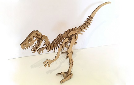 a wooden model of a velociraptor skeleton